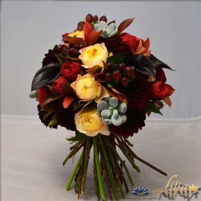 Bridal bouquet with black calla, roses and dahlia